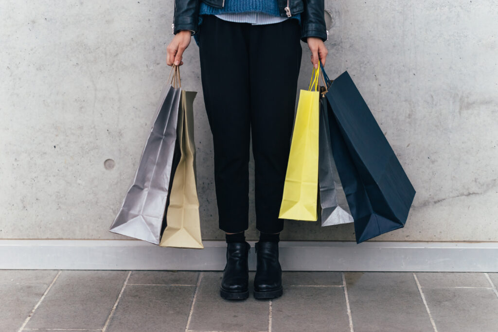 Woman With Shopping Bags, Grey Wall Background