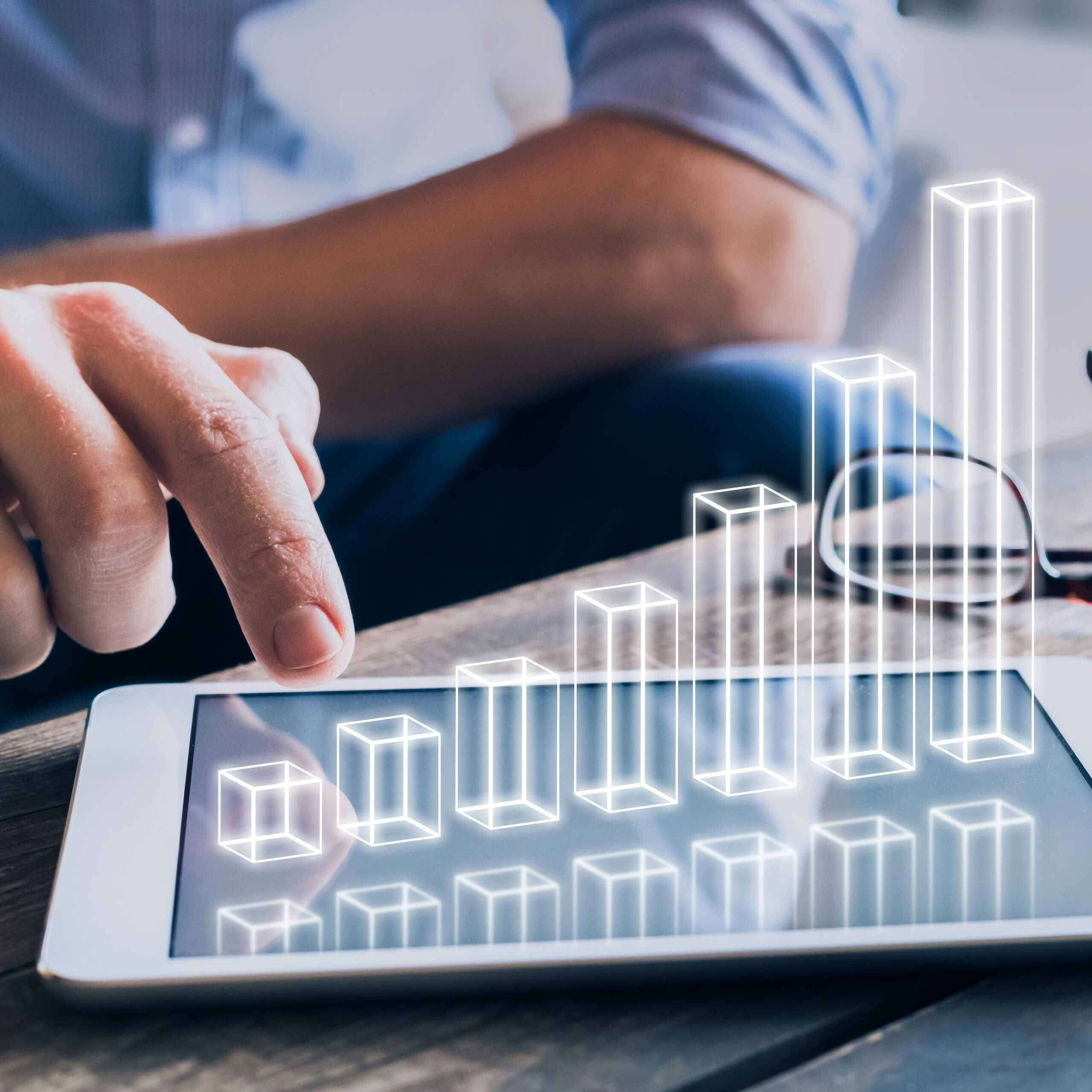 Businessman Analyzing Growing 3D AR Chart Above Tablet Computer Screen