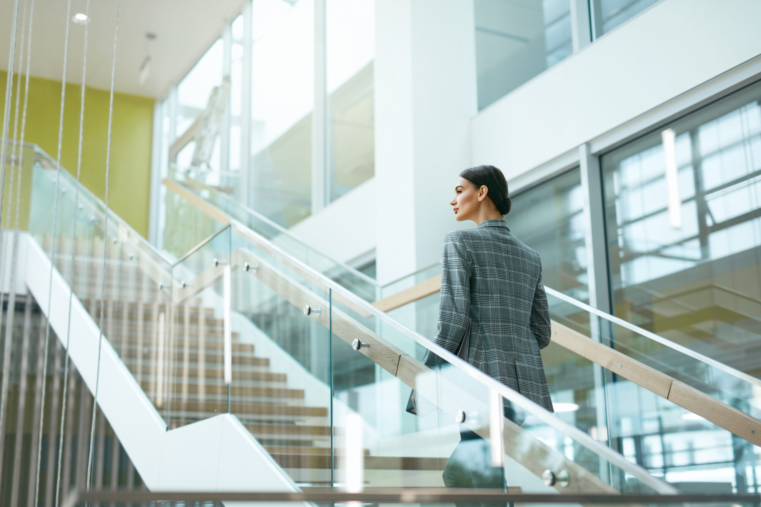 Female Worker On Stairs In Office Indoors